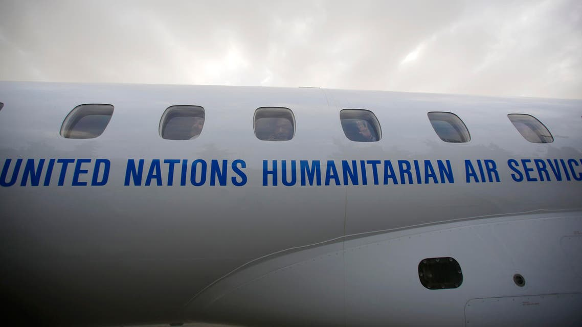 Yemeni political groups get on an airplane for Geneva for U.N.-led peace talks at the airport in Sanaa, Yemen, Sunday, June 14, 2015. (AP)