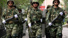China steps up controls in unruly Xinjiang as Ramadan approaches