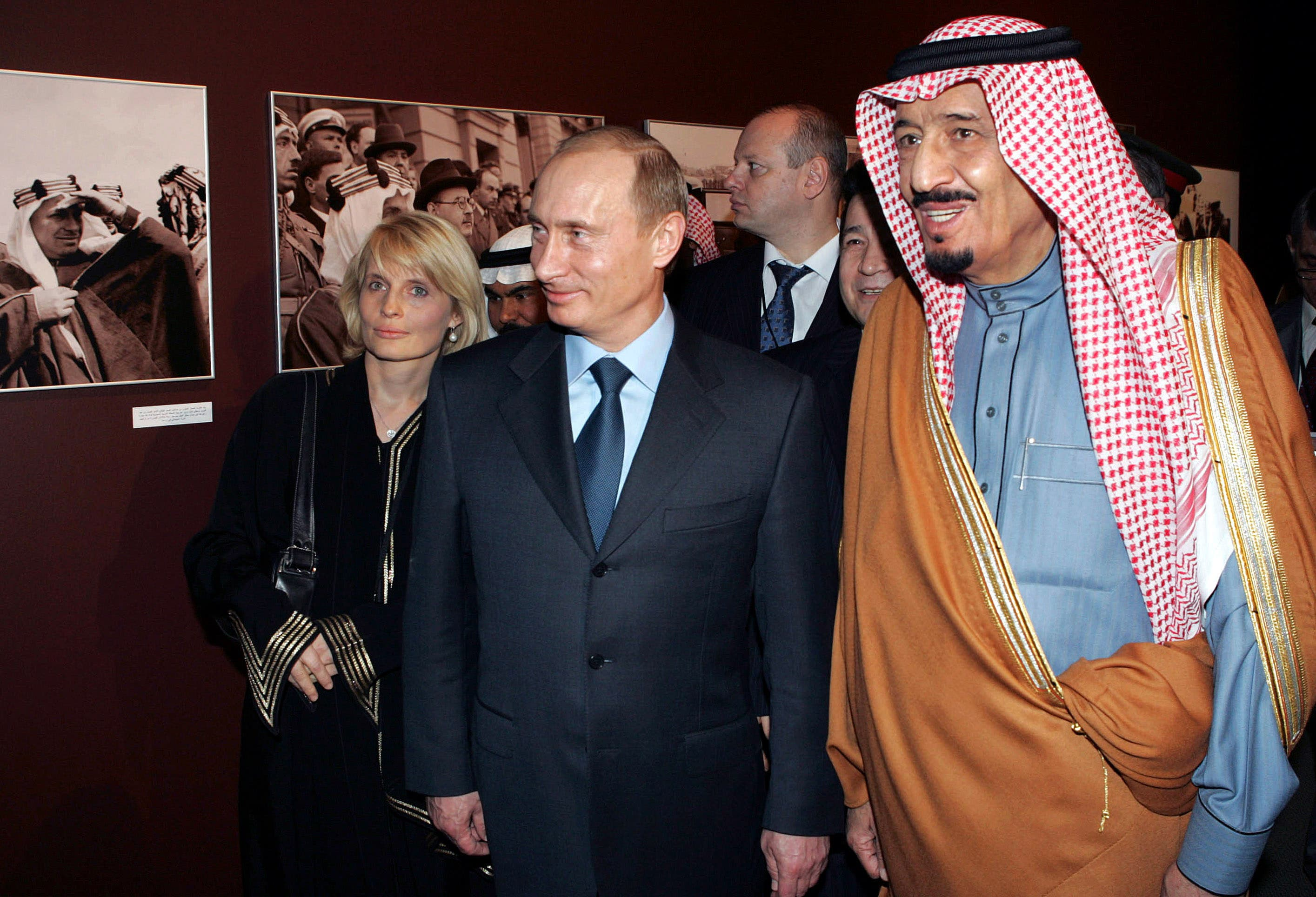 From right, Prince Salman bin Abdul Aziz, Saudi King's brother and Riyadh Governor, visiting Russian President Vladimir Putin and RIA Novosti News Agency Editor-in-Chief Svetlana Mironyuk tour a photo exhibition in Riyadh, Saudi Arabia, Monday, Feb. 12, 2007.