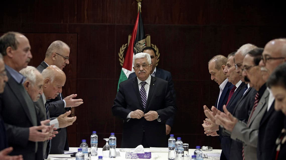 Palestinian President Mahmoud Abbas, center, joins in reading from the Quran prior to a meeting of the PLO executive committee in the West Bank city of Ramallah, Saturday, April 18, 2015. (AP)