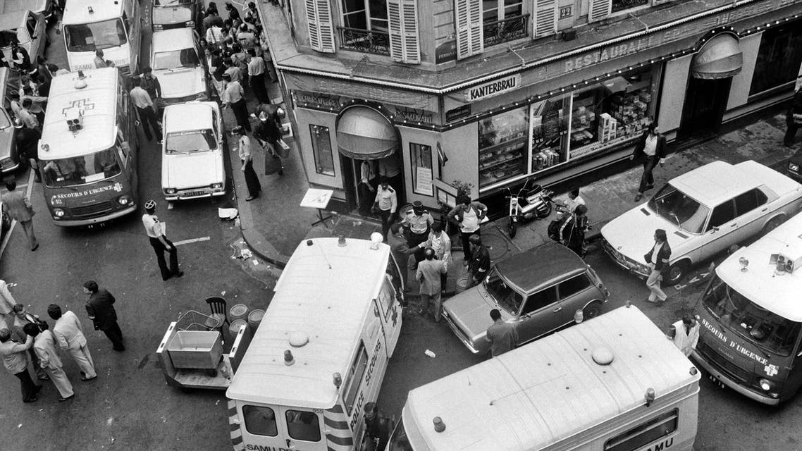 This file picture dated August 09, 1982 shows firemen and a rescuers in the rue des Rosiers after the French-Jewish delicatessen restaurant Jo Goldenberg was attacked in Paris by gunmen that threw a grenade into the restaurant and shot at customers with sub-machine guns, killing six customers and injuring 22 others. AFP
