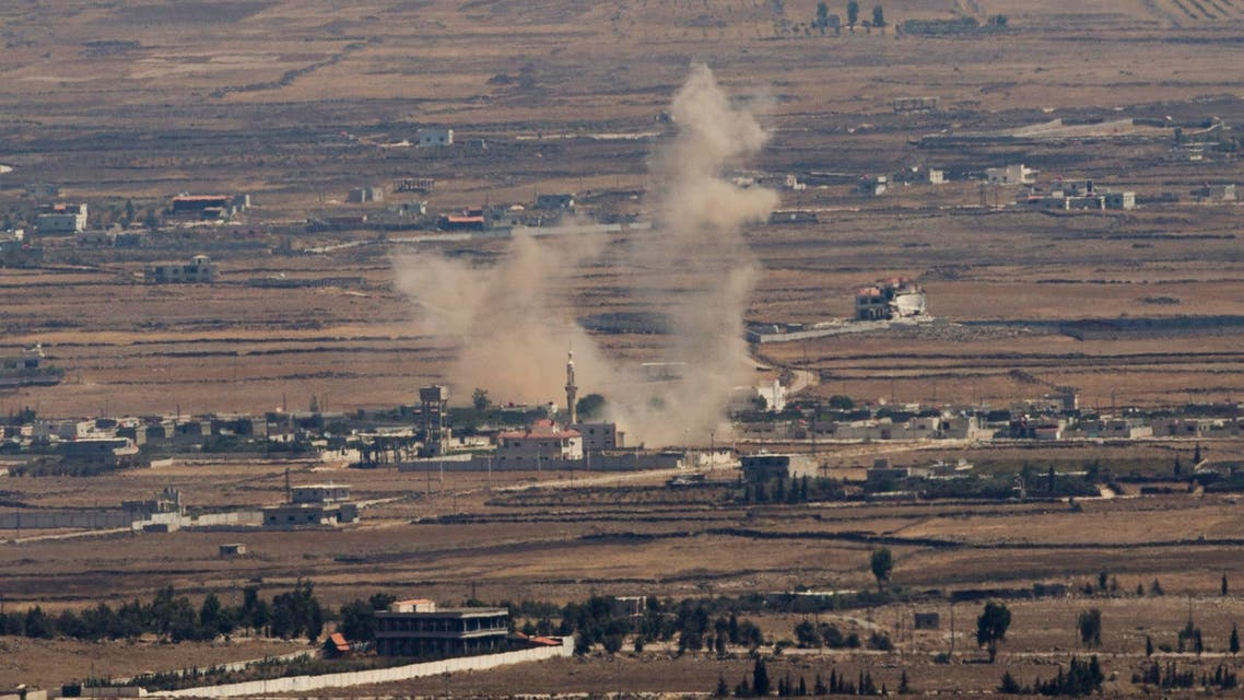 Smoke rises following an explosion in Syria's Quneitra province as Syrian rebels clashed with President Bashar Assad's forces, seen from the Israeli-controlled Golan Heights, Thursday, Aug. 28, 2014. AP