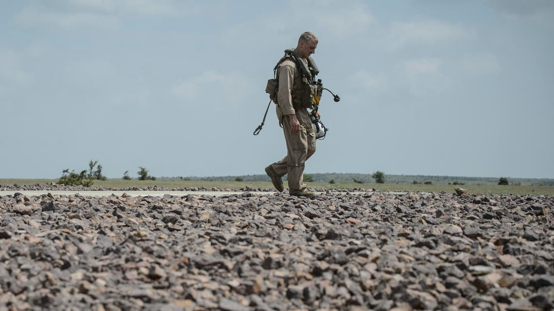 A United States marine walks during a joint military exercise with NATO Allies from Romania and Bulgaria, in Babadag Training Area, in Babadag, south-eastern Romania, Tuesday, May 26, 2015. (AP)