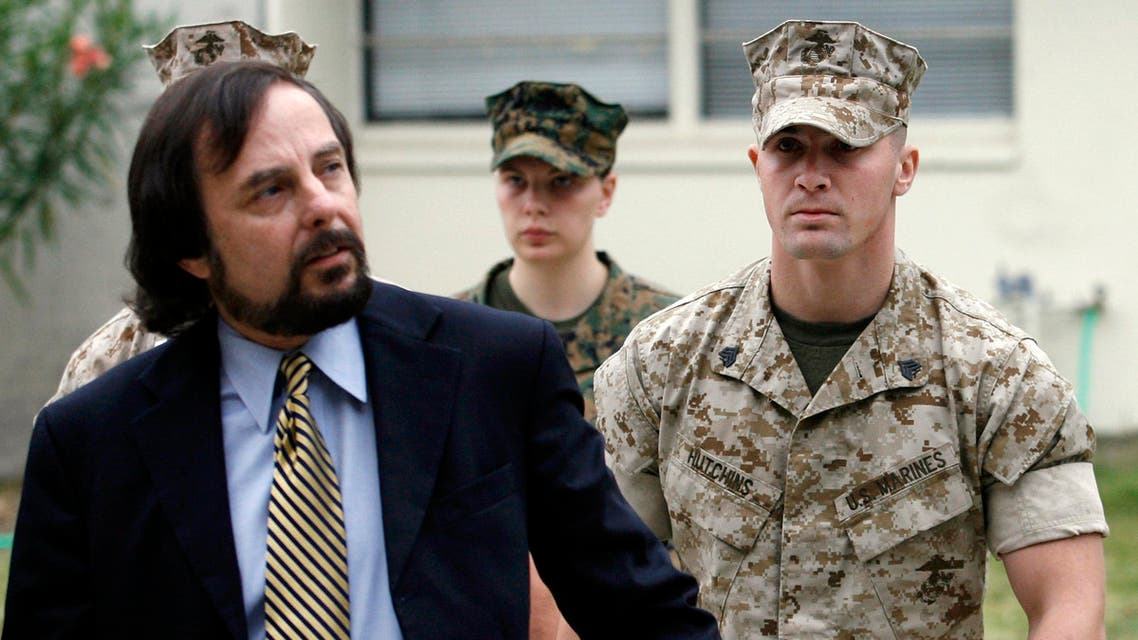 Marine Corps Sgt. Lawrence Hutchins, right, is escorted into his preliminary hearing by his civilian defense counsel J. Richardson Brannon. (File: AP)