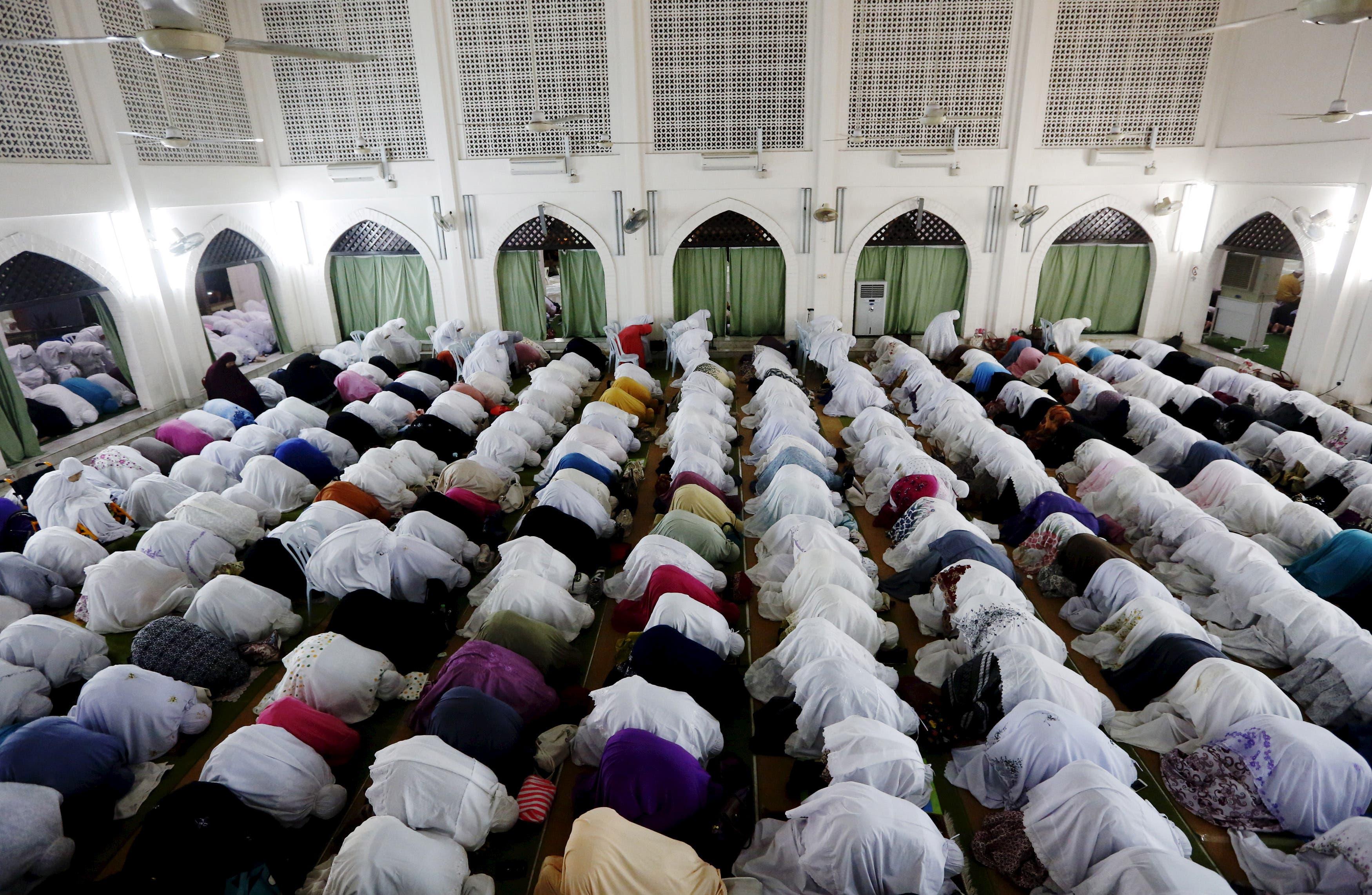 Muslims attend Ramadan prayer