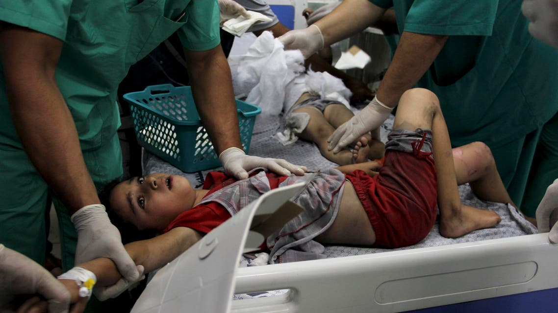 Palestinian doctors treat children wounded in an Israeli airstrike on a building, at the treatment room of al Najar hospital in Rafah in the southern Gaza Strip, Thursday, Aug. 21, 2014. (File: AP)