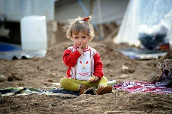 طفلة سورية في مخيم للاجئين