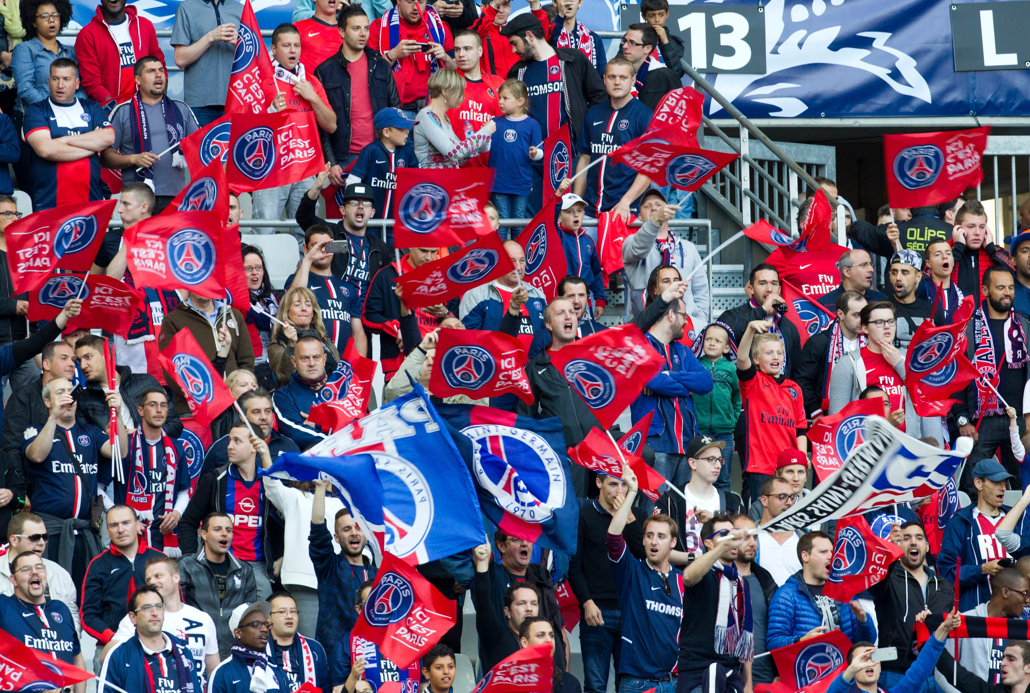 Paris Saint Germain (PSG) fans celebrate during the French Cup final soccer match between PSG and Auxerre at the Stade de France Stadium, in Saint Denis, north of Paris, Saturday May 30, 2015. PSG won 1-0. (AP Photo/Jacques Brinon)