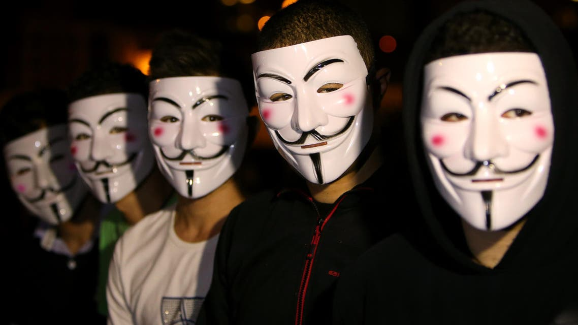 Lebanese activists wear masks as they protest against corrupt governments and corporations, in support of the anonymous activist moment, at the Martyrs square, in downtown Beirut, Lebanon, Tuesday, Nov 5, 2013. (AP)