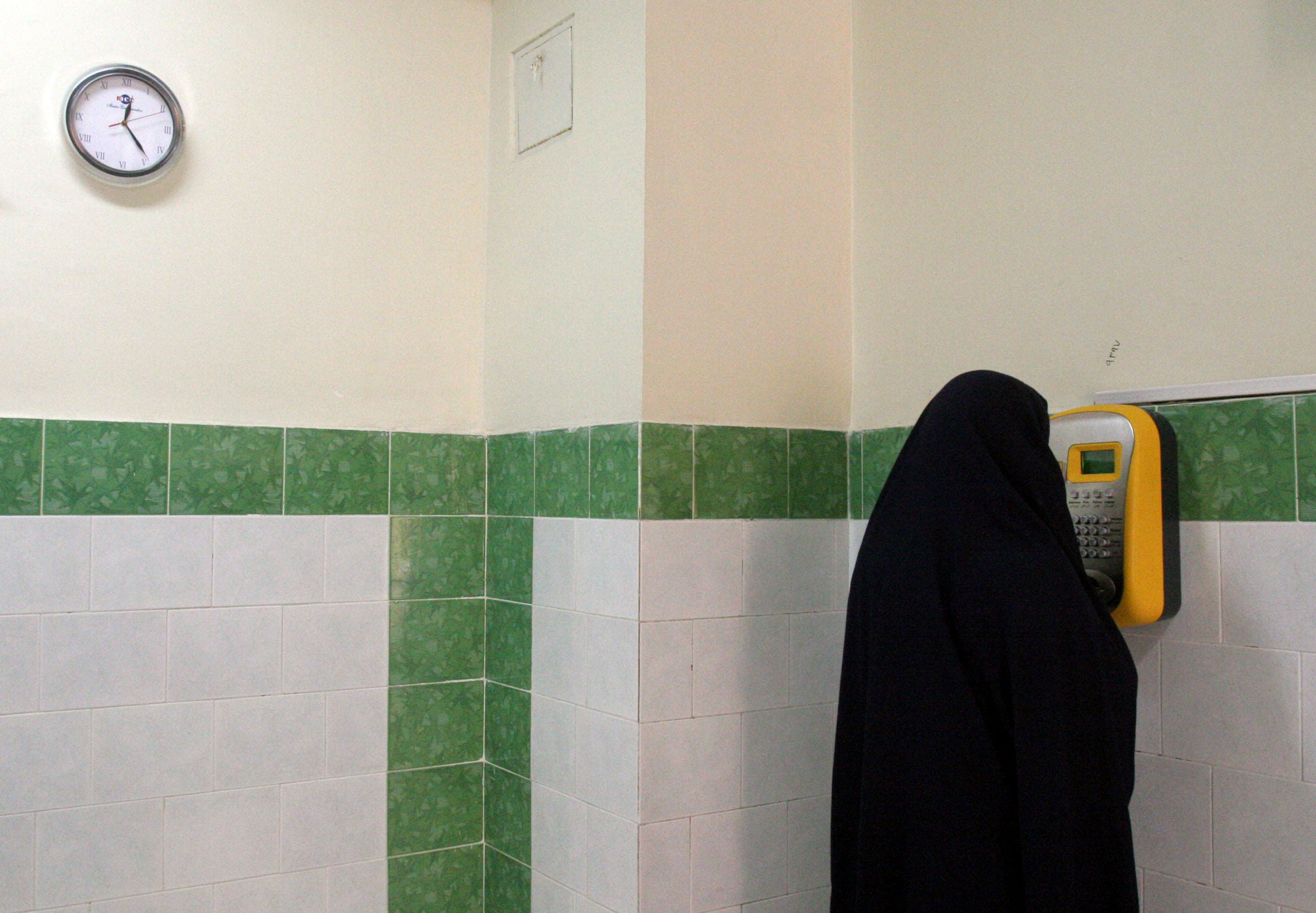An Iranian female prisoner makes a call in a corridor in the Evin prison in Tehran, Iran. (File: AP)
