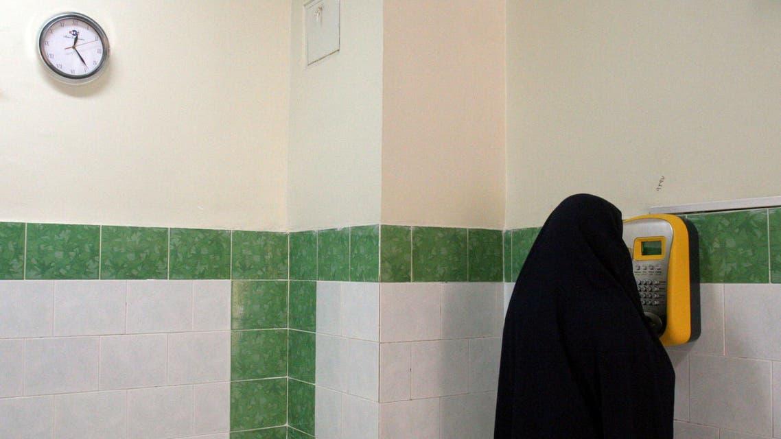 An Iranian female prisoner makes a call in a corridor in the Evin prison in Tehran, Iran. (File: AP)