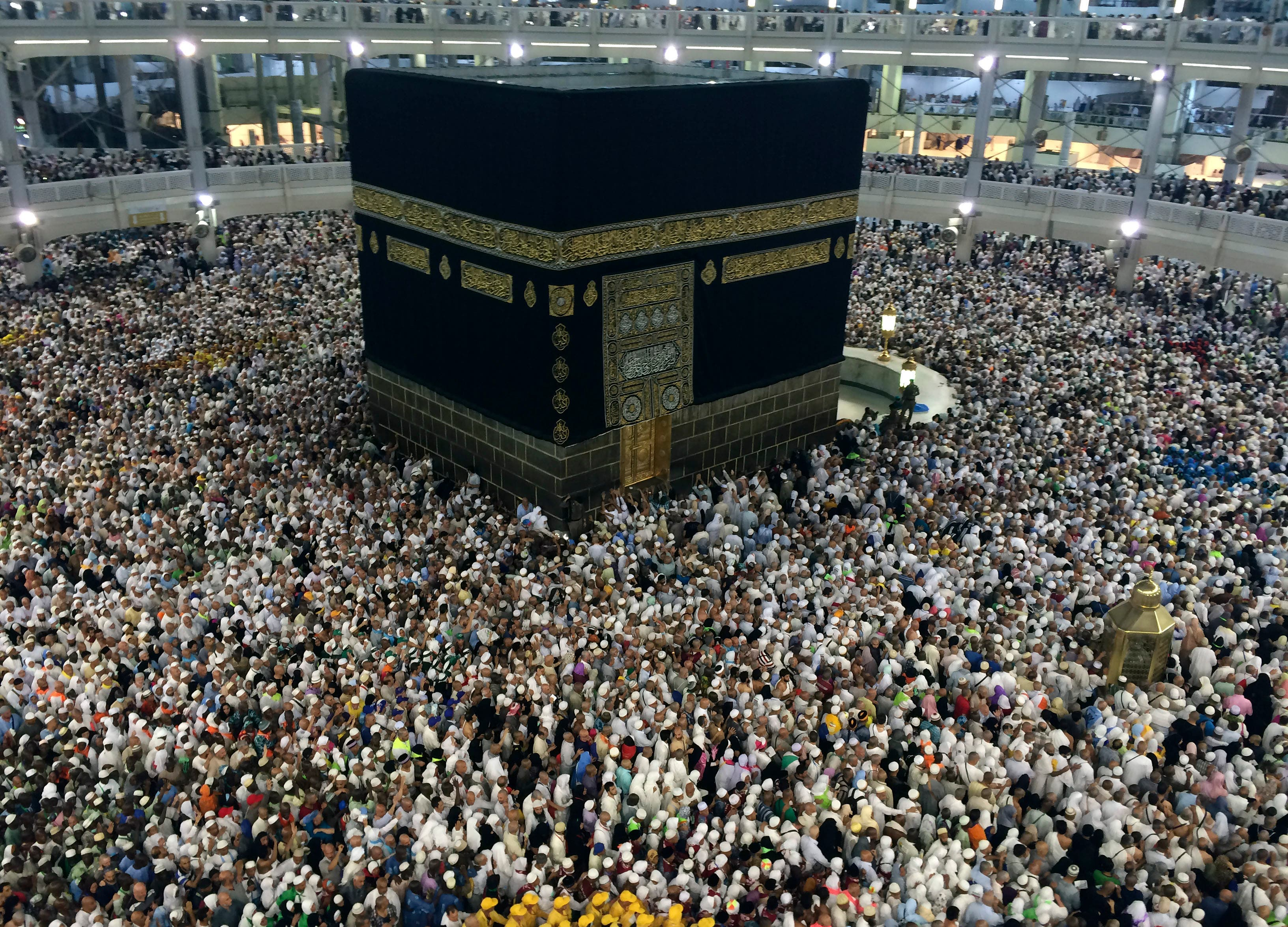 Muslim pilgrims circle the Kaaba, the black cube at center, inside the Grand Mosque during the annual pilgrimage, known as the hajj, in the Muslim holy city of Mecca, Saudi Arabia AP