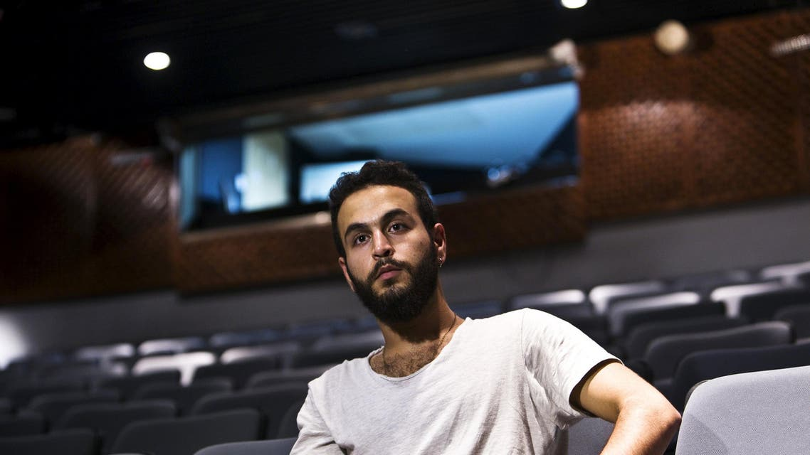 """Bashar Murkus, author and director of 'A Parallel Time"""", sits in Almidan theater during an interview, in the Israeli northern city of Haifa June 17, 2015. Israel froze state funding on Tuesday for an Arab theatre whose play about jailed Palestinians angered the right, fuelling accusations that the government aims to suppress productions it deems pro-Palestinian. Culture Minister Miri Regev, who has threatened to divert money from institutions seeking to """"hurt the state"""", said that irregularities discovered in al-Midan theater's finances led to her decision to withhold government money. REUTERS/Nir Elias"""