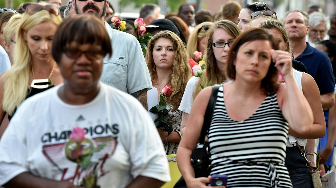 People line up to lay flowers at Emanuel AME Church in Charleston, South Carolina, on June 19, 2015. AFP