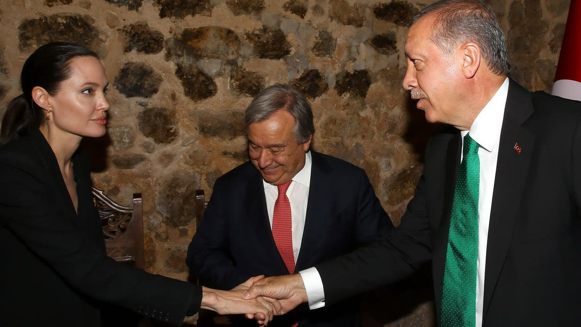 Turkey's President Recep Tayyip Erdogan, right, shakes hands with U.S. actress Angelina Jolie, left, Special Envoy of the United Nations High Commissioner for Refugees on June 20, 2015 (AP)