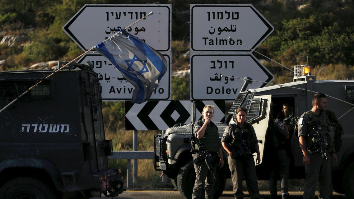 Israeli border police stand guard after a shooting attack, near the Jewish settlement of Dolev near the West Bank city of Ramallah June 19, 2015. (Reuters)