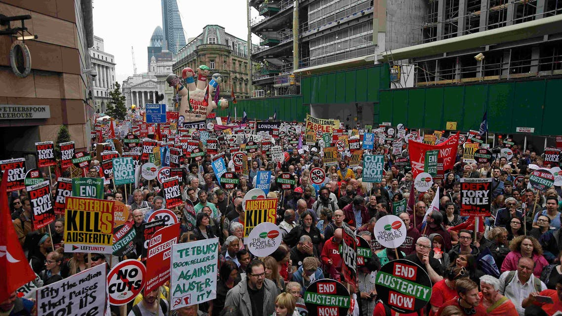 Demonstrators march during an anti-austerity protest in central London, Britain June 20, 2015. (Reuters)