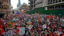Thousands march in London against new UK government's austerity plan