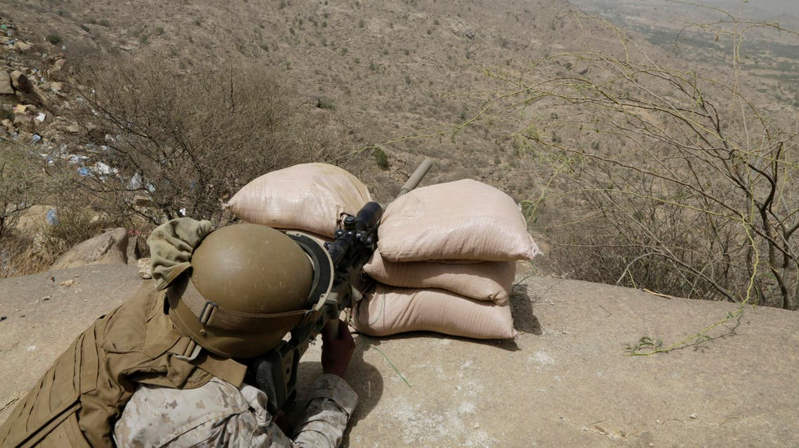A Saudi soldier aims his weapon from behind a sandbag barricade at the border with Yemen in Jazan, Saudi Arabia, Monday, April 20, 2015. AP