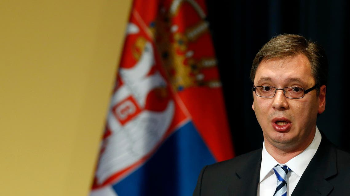 Serbia's Prime Minister Aleksandar Vucic speaks during a press conference in Belgrade, Serbia, Friday, June 19, 2015. Vucic, who is a former hardline nationalist, said he is ready to attend the memorial ceremonies in July marking the 20th anniversary of the massacre in Srebrenica.(AP Photo/Darko Vojinovic)