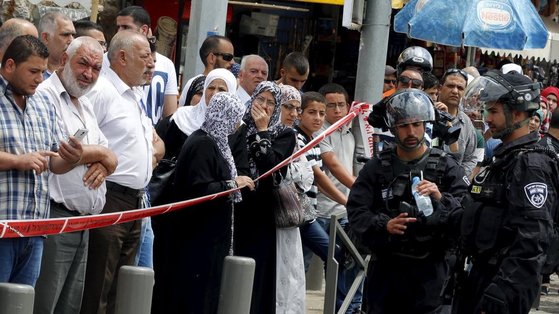 Onlookers stand at the scene of a stabbing near the Damascus Gate of Jerusalem's Old City June 21, 2015. (Reuters)