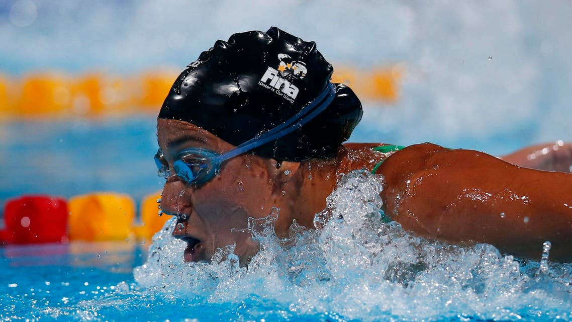 Egypt's Farida Osman competes in a heat of the Women's 100m butterfly at the FINA Swimming World Championships in Barcelona, Spain, Sunday, July 28, 2013.