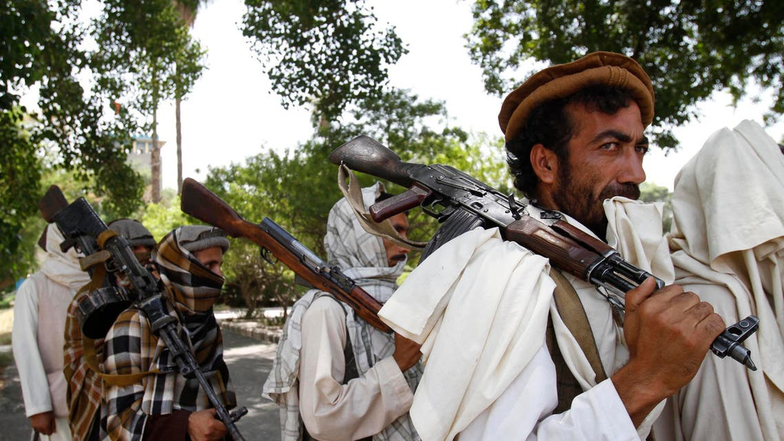 Taliban fighters hold their heavy and light weapons before surrendering them to Afghan authorities in Kabul on July 31, 2011. (File Photo: AP)