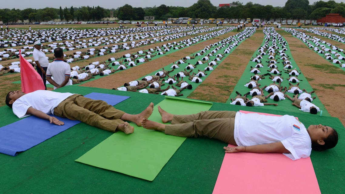 National Cadet Corps (NCC) participate in a mass yoga session to mark International Yoga Day at the parade grounds in Secunderabad, the twin city of Hyderabad on June 21, 2015. AFP