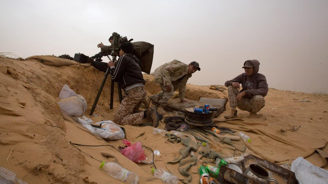 In this Saturday, Feb. 21, 2015 photo, Libyan soldiers aim their weapons during clashes with militants on the frontline in Al Ajaylat. (File photo: AP)