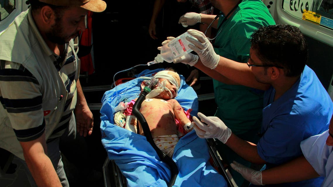 Medics treat a Palestinian child wounded in shelling in Rafah, southern Gaza Strip, Saturday, Aug. 2, 2014. AP