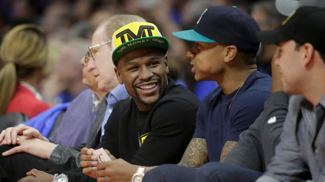 Floyd Mayweather Jr. sits courtside during the first half of Game 6 in a second-round NBA basketball playoff series between the Los Angeles Clippers and the Houston Rockets in Los Angeles, Thursday, May 14, 2015. (AP)