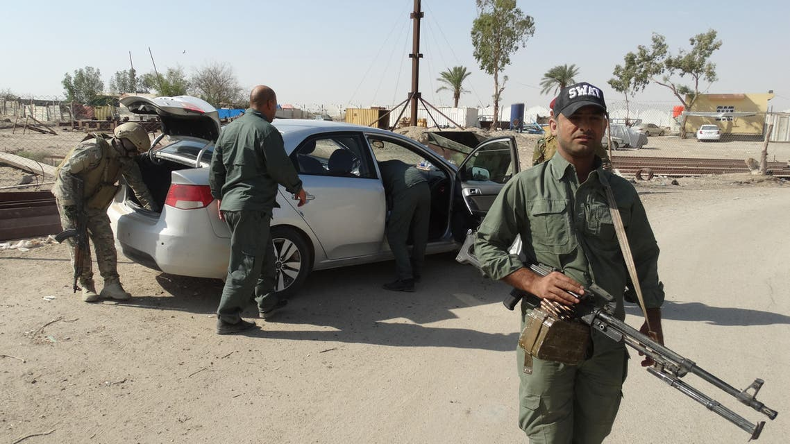 Iraqi security forces search a vehicle during a security operation to arrest Islamic State extremists and confiscate weapons at a refugee camp in Habaniyah, 80 kilometers (50 miles) west of Baghdad, Iraq, Thursday, June 18, 2015. (AP Photo)