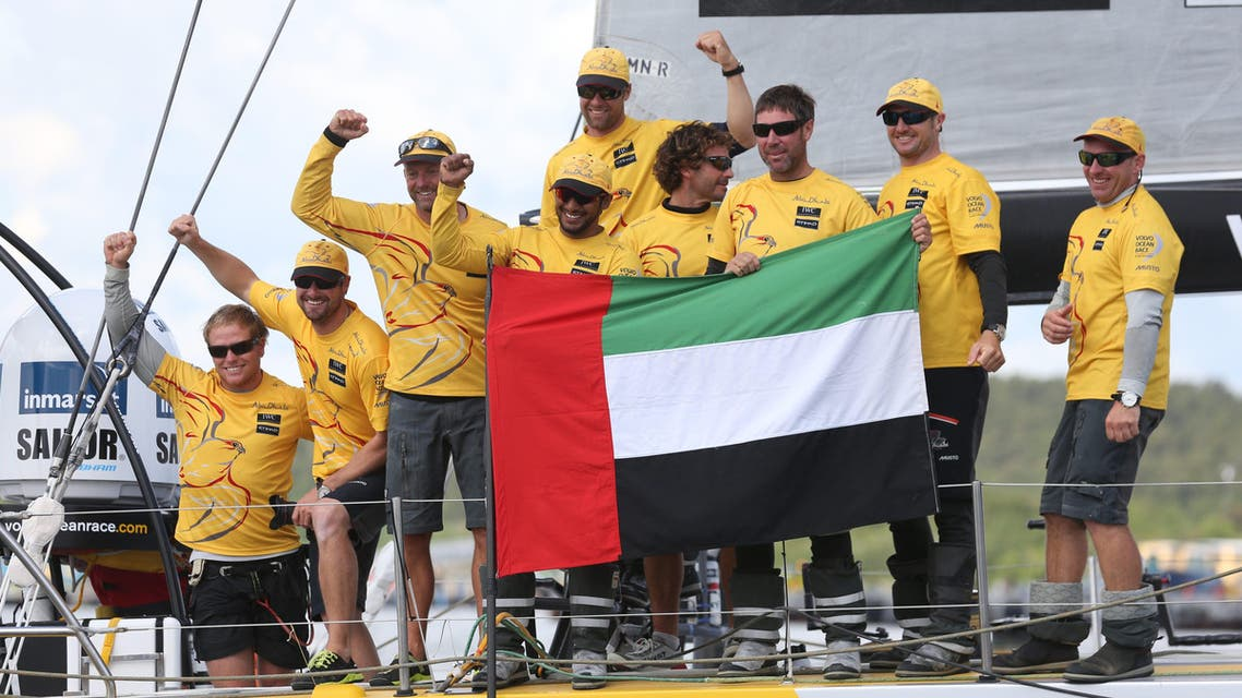 Overall winner Abu Dhabi Ocean Racing team skippered by Britain's Ian Walker, 3rd left, celebrate after crossing the finish line of the 9th leg of the Volvo Ocean Race from French Lorient to Gothenburg, in Gothenburg, Sweden, on Monday June 22, 2015. AP