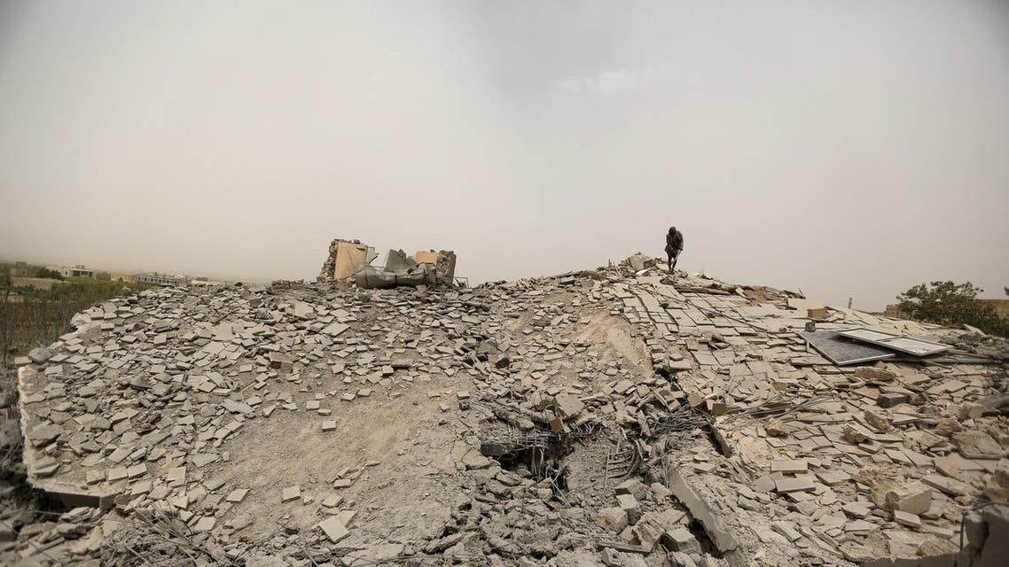Guard stands on the collapsed roof of the house of General Ali al-Dhafif, a Yemeni army brigade commander, after it was hit by Saudi-led air strikes near Sanaa, Yemen. (Reuters)
