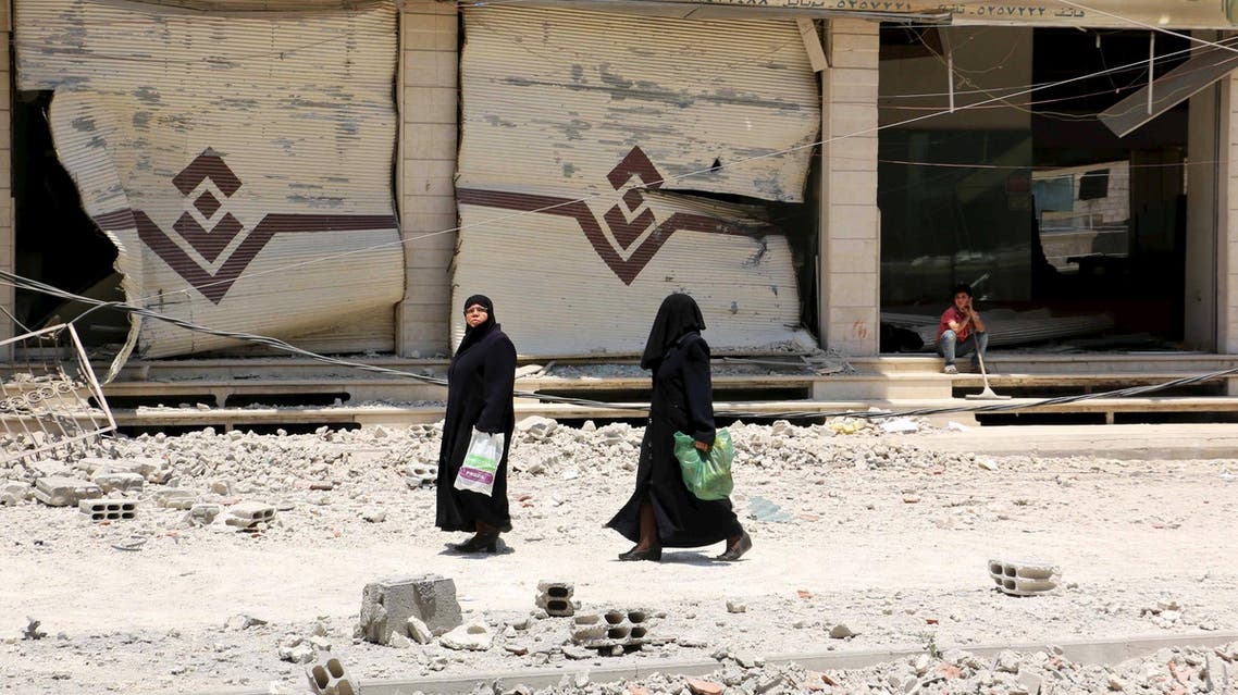 Two women walk at a site hit by what activists said was an airstrike by forces loyal to Syria's President Bashar al-Assad, at the eastern Ghouta of Damascus June 5, 2015. (Reuters)