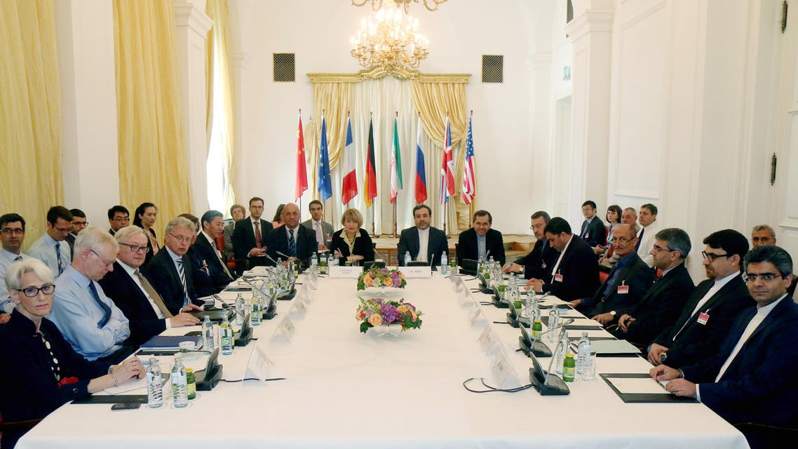 In this Friday, June 12, 2015 file photo delegates sit around a table prior to a bilateral meeting as part of the closed-door nuclear talks with Iran at a hotel in Vienna, Austria. Iran and six powers are still apart on all main elements of a nuclear deal with less than two weeks to go to their June 30 target date and will likely have to extend their negotiations, two diplomats tell The Associated Press. (AP Photo/Ronald Zak, File)
