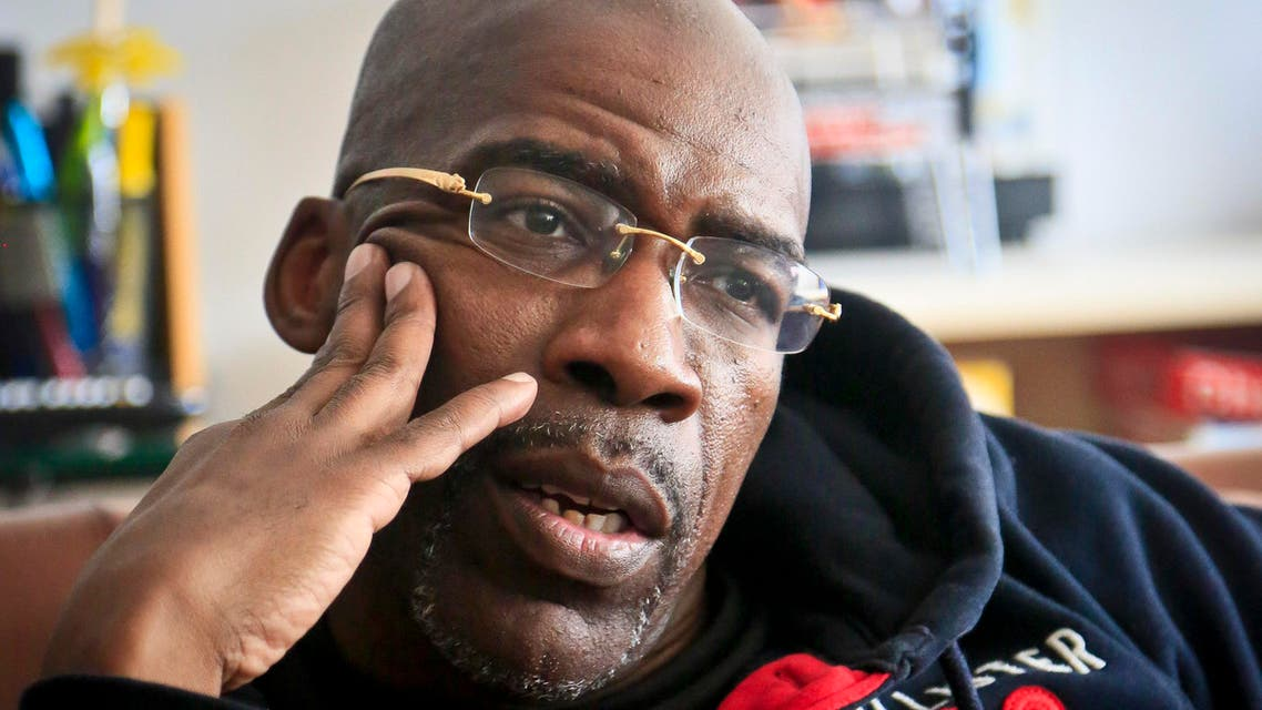 In this April 18, 2014 file photo, Jonathan Fleming, who was exonerated of murder after almost 25 years behind bars, listens during a visit with his lawyer in New York. New York City has agreed to pay $6.25 million to Fleming the city comptroller said Tuesday, June 23, 2015.