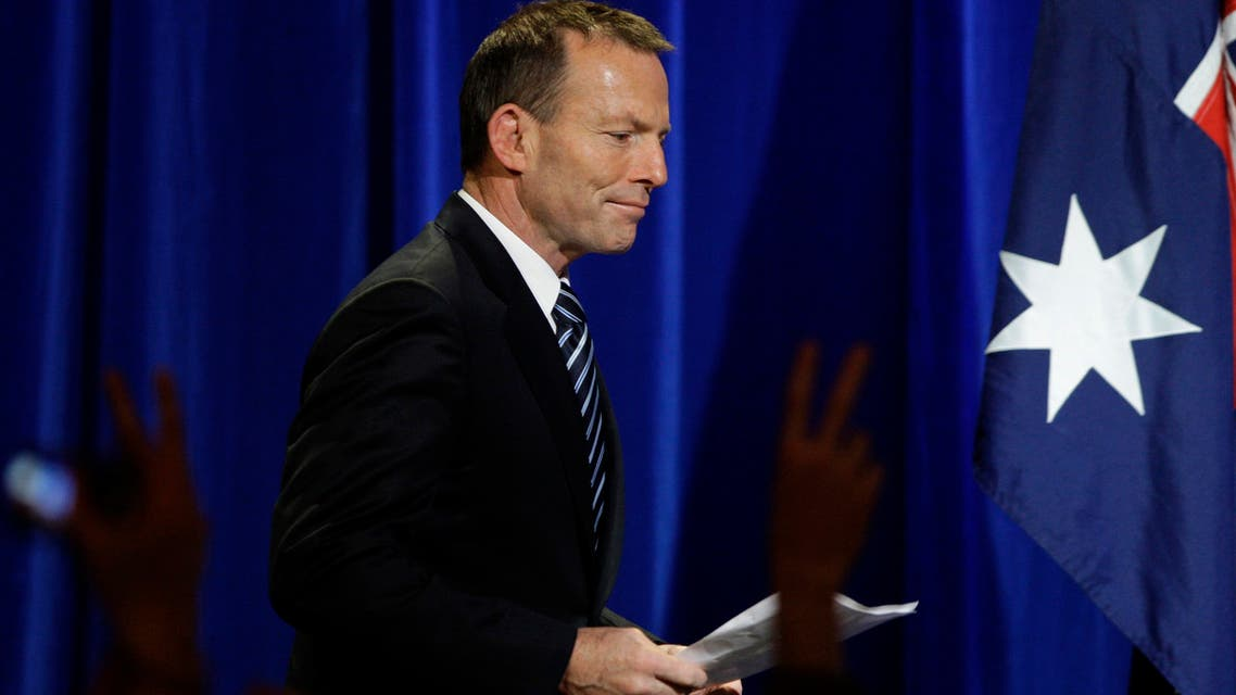 Liberal Party leader Tony Abbott arrives to address a crowd of supporters in Sydney, Sunday, Aug. 22, 2010, following a national election.
