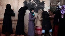 Syria's economy more than halves during conflict