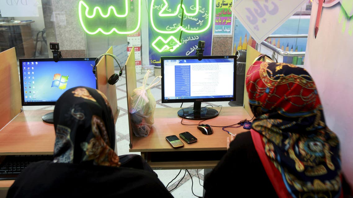 Two Iranian women surf the Internet at a cafe in Tehran, Iran, Tuesday, Sept, 17, 2013. AP