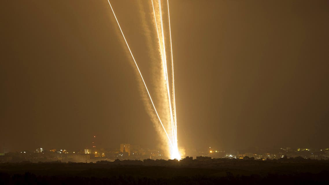 File photo of light streaks and smoke trails seen as rockets are launched from Gaza towards Israel. (Reuters)