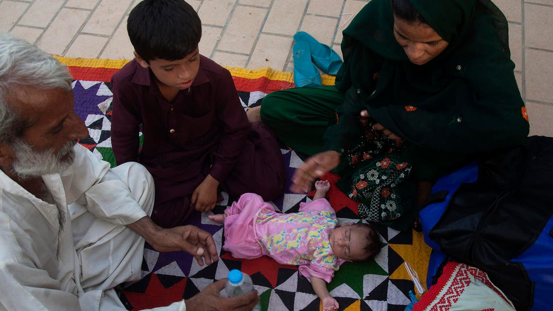 Family members surround a child suffering from dehydration due to sever heat, at a local hospital in Karachi, Pakistan, Tuesday, June 23, 2015. AP