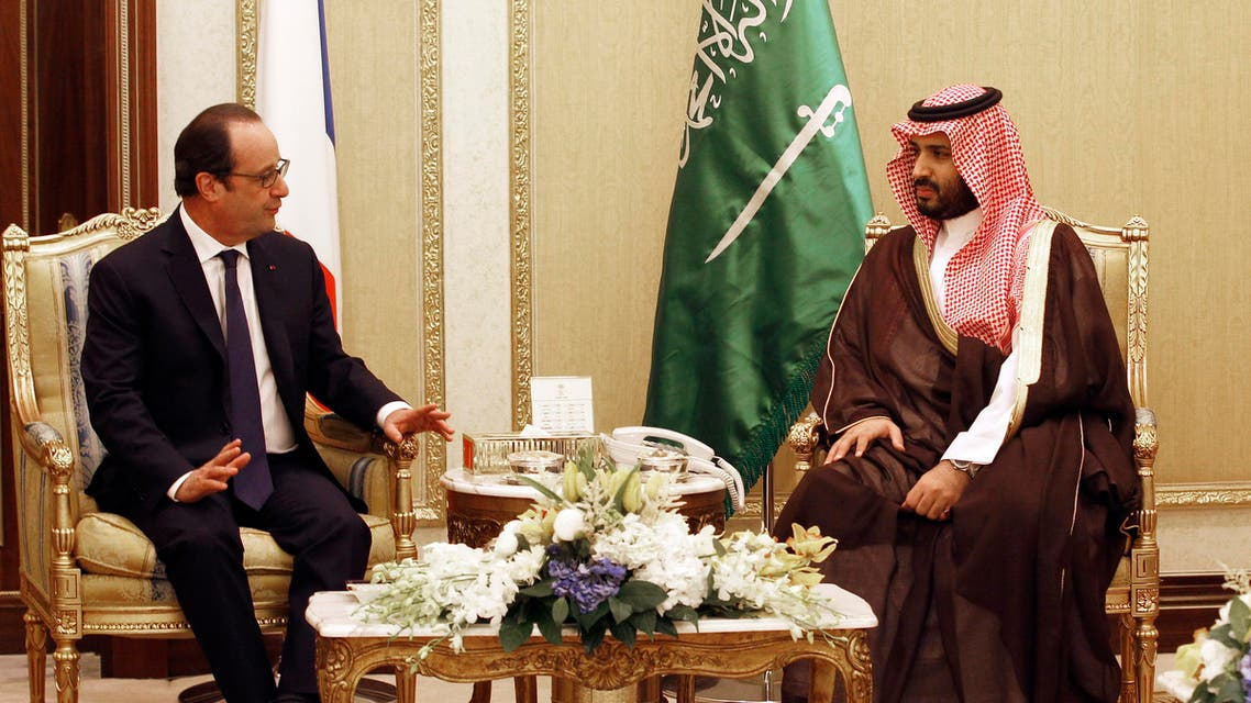 French President Francois Hollande, left, talks with Saudi Arabia's Deputy Crown and Defense Minister Prince Moahmmed bin Salman, andduring a meeting in Riyadh, Saudi Arabia, Tuesday, May 5, 2015.