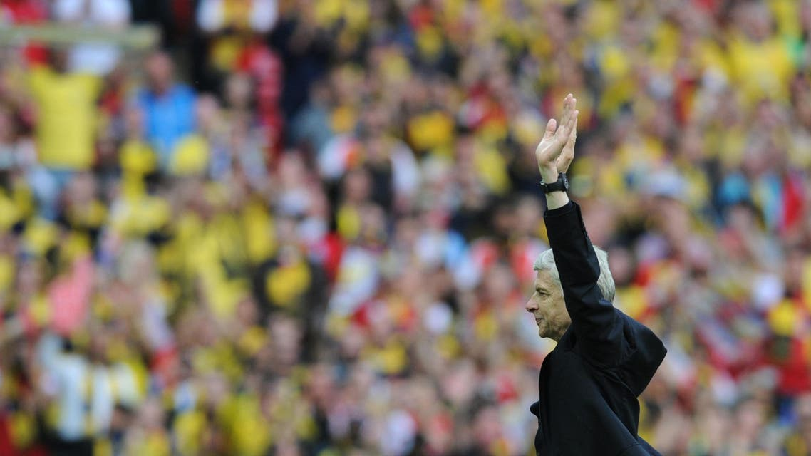 Arsenal manager Arsene Wenger salutes the fans after his team won the FA Cup in the English FA Cup Final soccer match between Aston Villa and Arsenal at Wembley stadium, London, Saturday, May 30, 2015. (AP Photo/Rui Vieira)