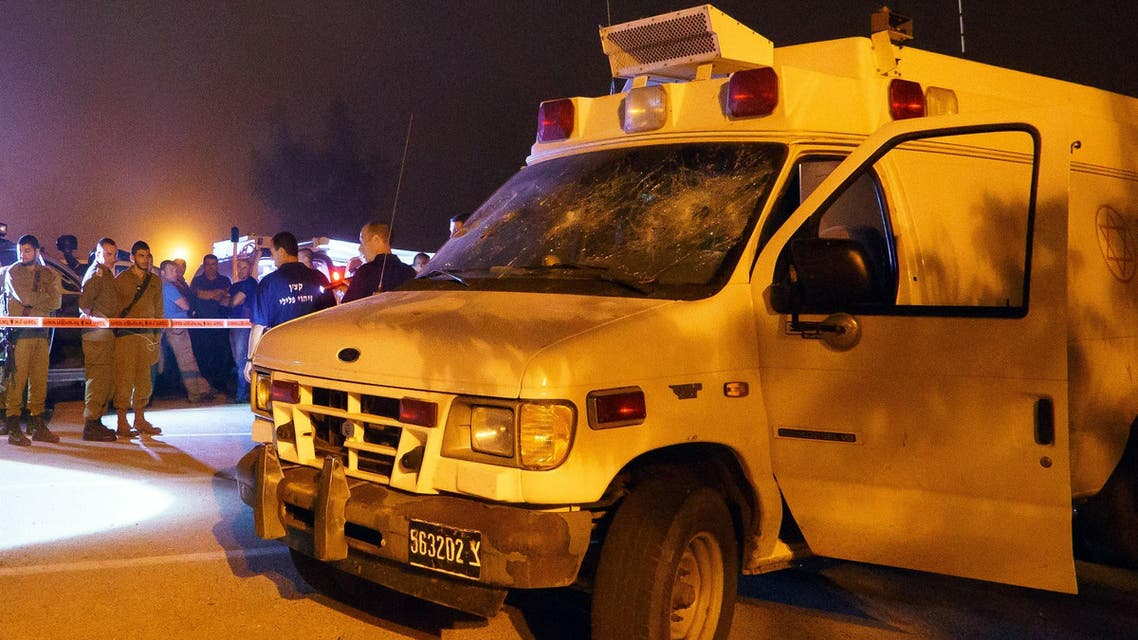 Israeli security personnel check an Israeli military ambulance which was attacked by Israeli Druze in the Israeli settlement of Neve Ativ, near Majdal Shams on the Israeli-annexed Golan Heights, as it was on its way to a hospital carrying two injured Syrians for treatment on June 22, 2015. Public radio earlier said that around 200 Druze from Majdal Shams had pelted the ambulance with stones, forcing it to stop, and dragged the wounded Syrians from the vehicle leaving one dead and the other in a serious condition. AFP PHOTO / STR