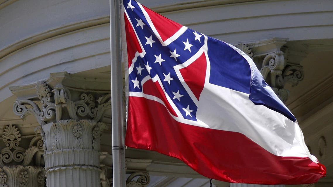 The state flag of Mississippi is unfurled against the front of the Governor's Mansion in Jackson, Miss., Tuesday, June 23, 2015. Republican Lt. Gov. Tate Reeves said Tuesday, that Mississippi voters, not lawmakers, should decide whether to remove the Confederate battle emblem from the state flag. Reeves, who presides over the state Senate, spoke about the issue a day after Republican House Speaker Philip Gunn called the emblem offensive and said the state flag should change. (AP Photo/Rogelio V. Solis)