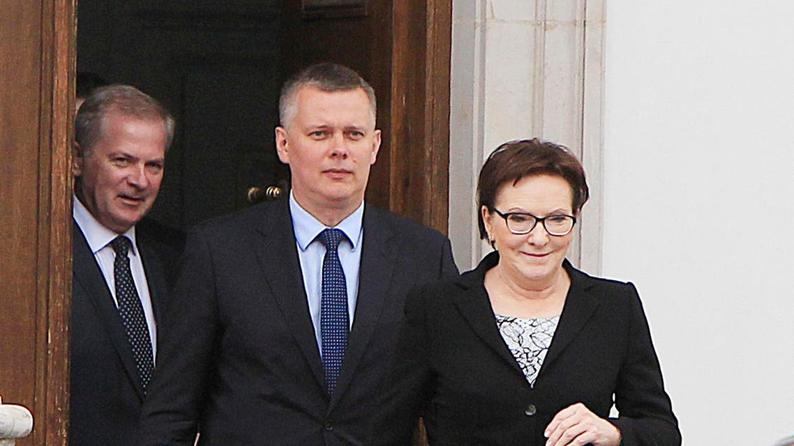 Polish Prime Minister Ewa Kopacz, right, and her deputy, Defense Minister Tomasz Siemoniak, center, leaving the Belvedere Palace in Warsaw, Poland, on Monday, June 15, 2015 AP