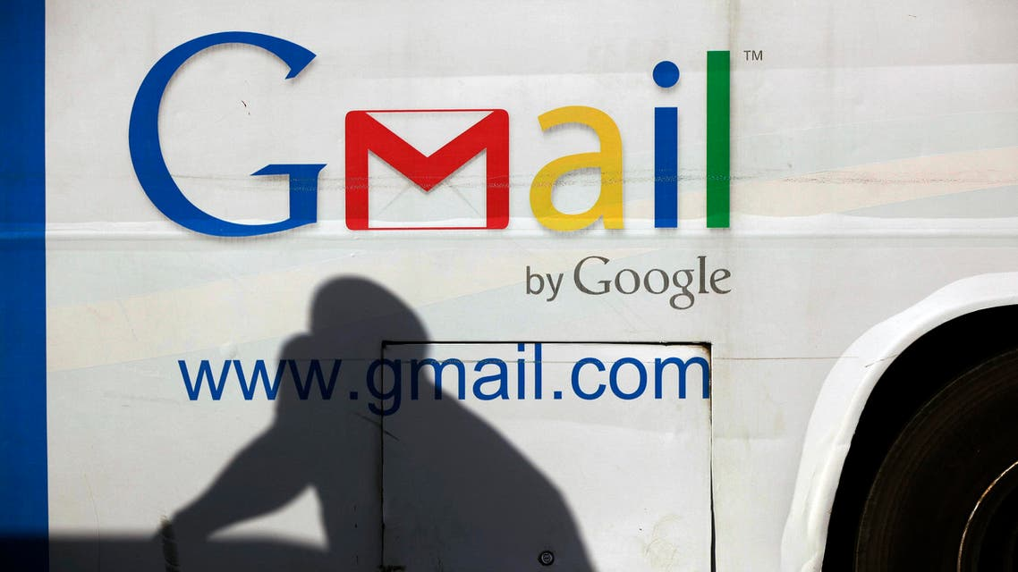 In this Monday, Sept 17, 2012, file photo an unidentified man's shadow reflects on a commercial bus with an advertisement for Google Mail, in Lagos, Nigeria. (File Photo: AP)