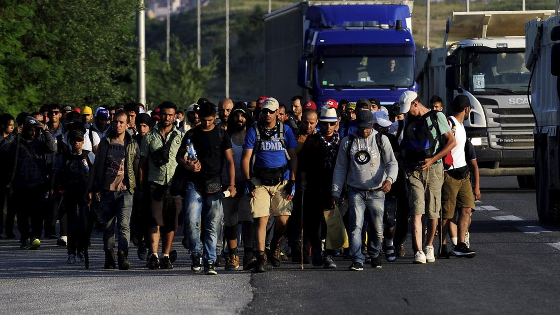 Immigrants from Syria walk on a motorway at Tabanovce near the Serbian border with Macedonia June 19, 2015. (Reuters)