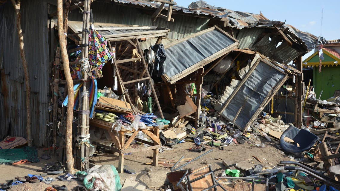 Debris at the site of a suicide bomb attack at a market in Maiduguri, Nigeria, Monday June 22, 2015. Two girls blew themselves up on Monday near a crowded mosque in northeast Nigeria's biggest city, killing about 30 people, witnesses said. It is the fourth suicide bombing this month in Maiduguri, which is the birthplace of the Boko Haram Islamic extremist group. (AP Photo/Jossy Ola)